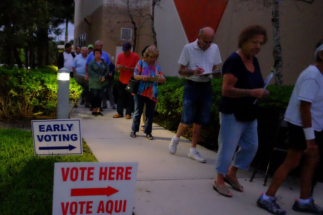 Voters in Delray Beach, Fla., stand in line at an early voting location to cast ballots on Friday. The Department of Homeland Security is working with 46 states to ensure election data is protected from potential hackers. Photo by Gary I. Rothstein/UPI