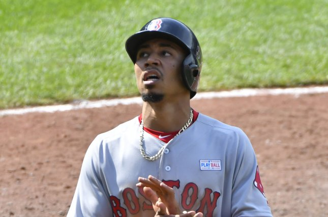 Boston Red Sox's Mookie Betts reacts after scoring a run. File photo by David Tulis/UPI