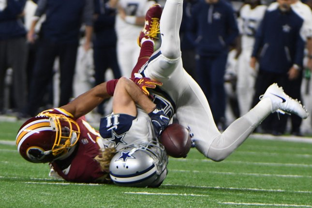 Dallas Cowboys wide receiver Cole Beasley makes a catch as Washington Redskins cornerback Kendall Fuller defends during the first half on November 30 at AT&T Stadium in Arlington, Texas. Photo by Ian Halperin/UPI