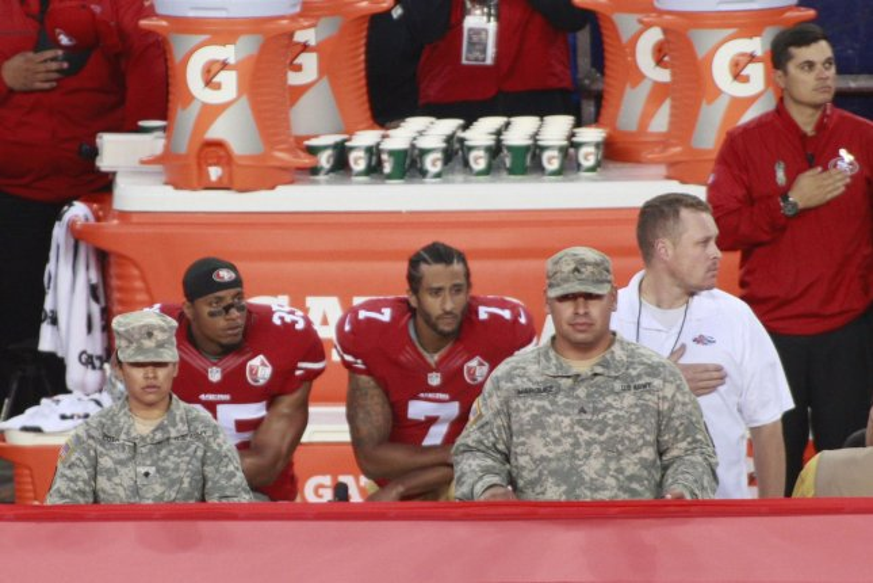 Former San Francisco 49ers QB Colin Kaepernick (7) kneels alongside teammate Eric Reid during the national anthem before playing the Los Angeles Rams at Levi's Stadium in Santa Clara, Calif. File photo by Bruce Gordon/UPI