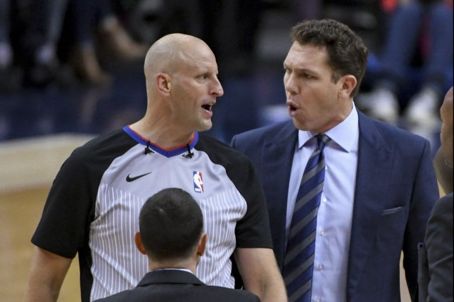 Sacramento Kings head coach Luke Walton (R) is under investigation for an alleged sexual assault of a female sports reporter. File Photo by Mark Goldman/UPI