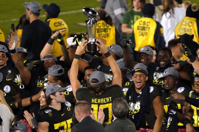 Oregon Ducks quarterback Justin Herbert was named was named Rose Bowl Offensive Most Valuable Player after scoring three rushing touchdowns in a win against Wisconsin Wednesday in Pasadena, Calif. Photo by Jon SooHoo/UPI