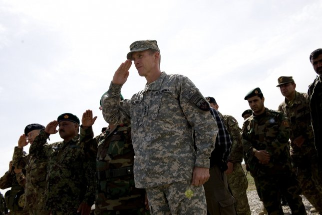 Gen. Stanley McChrystal inspects a guard of honor during ceremony at an aviation base for Afghan National Army in Herat, Afghanistan, on March 25, 2010. On June 23, 2010, McChrystal resigned as commander of U.S. and NATO troops in Afghanistan after he and senior aides made disparaging remarks in a magazine interview about administration officials. File Photo by Hossein Fatemi/UPI