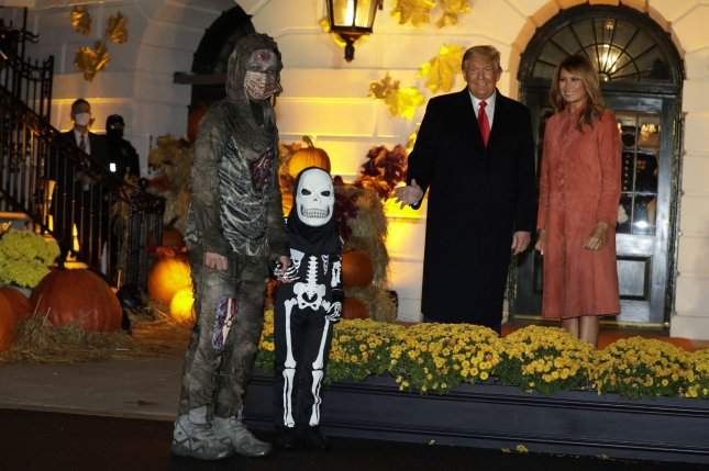 U.S. President Donald Trump and First Lady Melania Trump greet children in costume during a Halloween event on the South Lawn of the White House on Sunday. Photo by Yuri Gripas/UPI