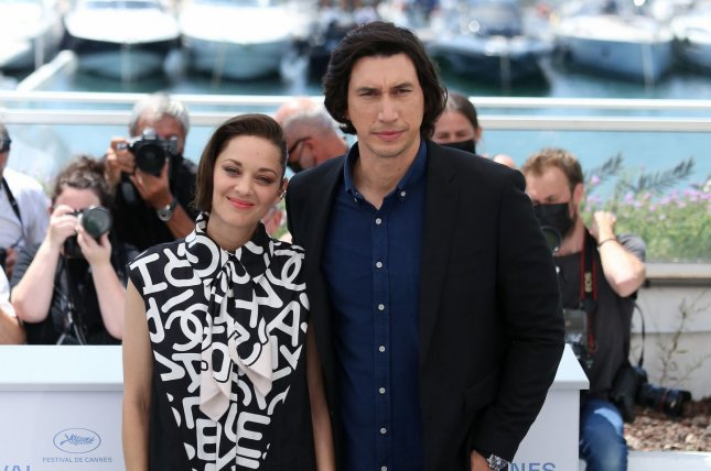 Marion Cotillard (L) and Adam Driver attend a Cannes Film Festival photocall for Annette in July. File Photo by David Silpa/UPI