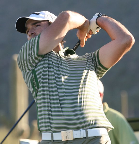 Oliver Wilson, shown in a 2009 file photo, is tied with Bradley Dredge for first after one rounds of the European PGA Tour's Qatar Masters. (UPI Photo/Art Foxall)