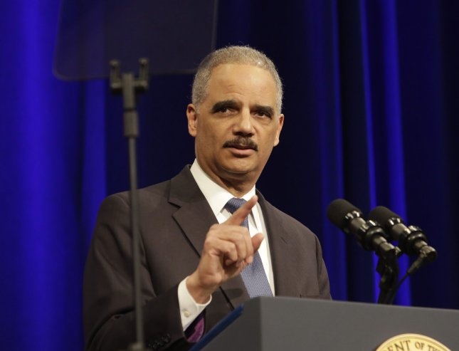 Former U.S. Attorney General Eric Holder said, in an intrerview released Monday, that Edward Snoweden's actions in revealing U.S. survellance programs was a public service, but that he must still face punishment. Pool photo by Chris Kleponis/UPI
