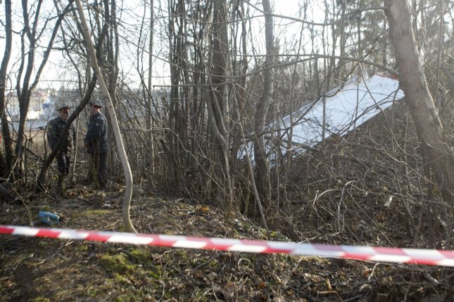 Wreckage from a Tupolev Tu-154 aircraft is seen near Smolensk, in western Russia, on April 10, 2010. Former Polish President Lech Kaczynski, his wife Maria and a number of high-ranking military and civilian leaders died when the plane crashed as it attempted to land in thick fog. Monday, the Kaczynskis' bodies were exhumed as part of a new look into the crash. File Photo by Alex Natin/UPI