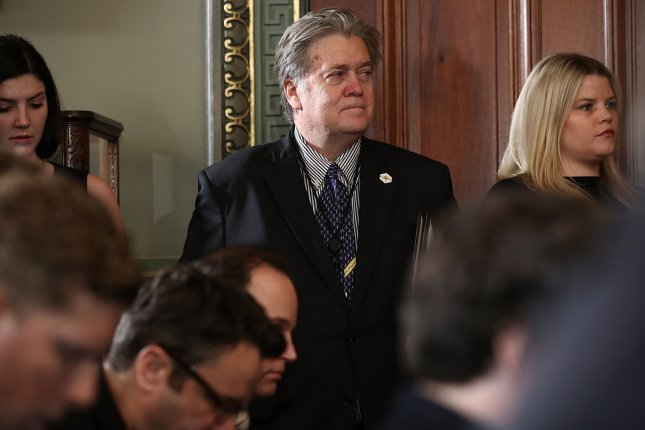 Steve Bannon, chief strategist and senior counselor to President Donald Trump (C), was named a member of Trump's National Security Council on Saturday, while the chairman of the Joint Chiefs of Staff and the Director of National Intelligence were removed. Pool photo by Win McNamee/UPI