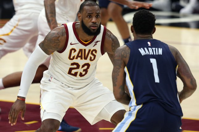 acbebad9dec9 Cleveland Cavaliers  LeBron James defends Memphis Grizzlies  Jarell Martin  during the second half on December 2 at Quicken Loans Arena in Cleveland
