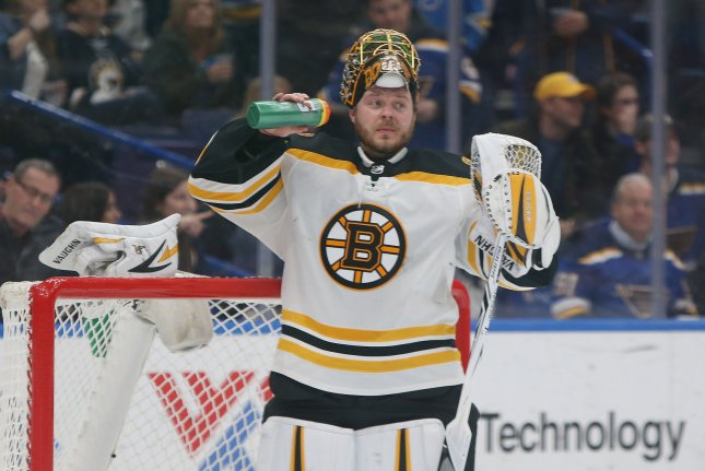 Boston Bruins goaltender Anton Khudobin of Kazakhstan watches as linesmen seperate St. Louis Blues players from his teammates during the first period on March 21 at the Scottrade Center in St. Louis, Mo. Photo by Bill Greenblatt/UPI