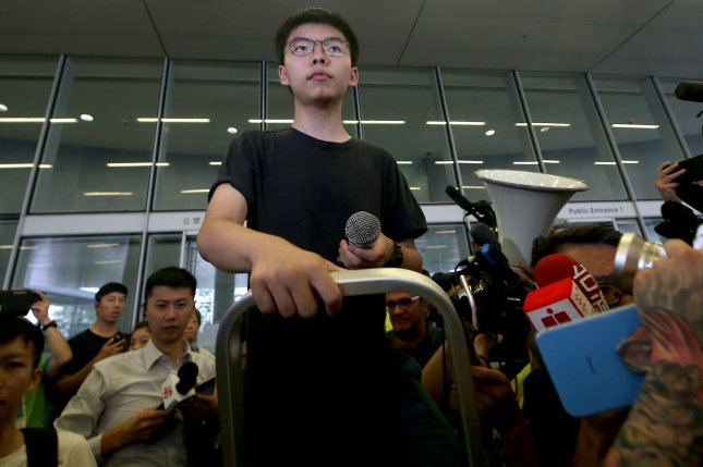 Hong Kong's most prominent student activist Joshua Wong prepares to talk with the gathered protestors just hours after he was released from prison in Hong Kong on Monday. Photo by Stephen Shaver/UPI