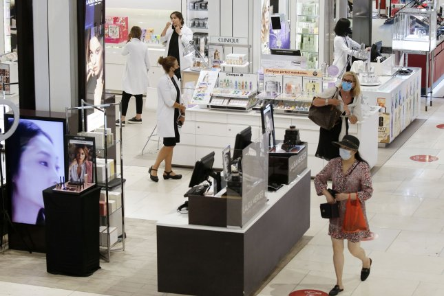 Shoppers walk through Macy's department store in New York City's Herald Square on June 22. After combined growth of nearly 30% in May and June, retail sales increased just 1.2% in July. File Photo by John Angelillo/UPI