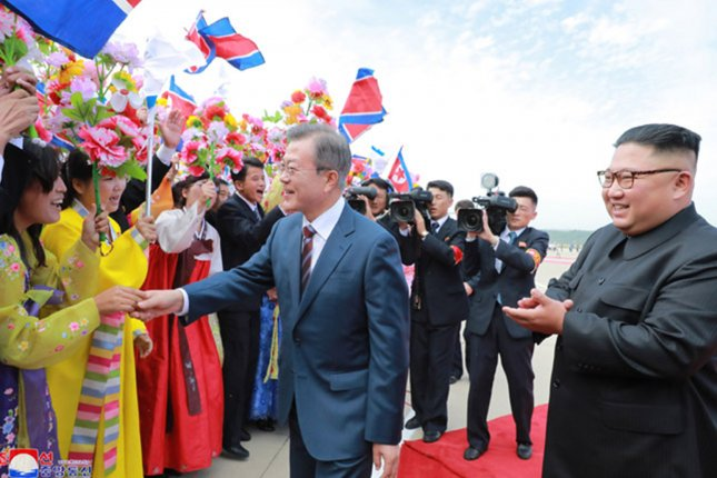 South Korean President Moon Jae-in (C) visiting Pyongyang, North Korea in September 2018. Moon says he remains open to continued dialogue with Kim Jong Un (R). File Photo by KCNA/UPI