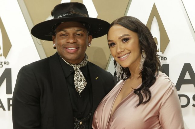 Jimmie Allen (L) married his girlfriend, Alexis Gale, at a small ceremony with family and friends. File Photo by John Angelillo/UPI
