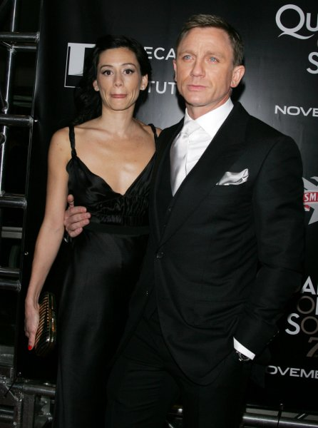 Daniel Craig and date arrive for the Tribeca Film Institute Benefit Screening of Quantum of Solace at the AMC Lincoln Square Theater in New York on November 11, 2008. (UPI Photo/Laura Cavanaugh)