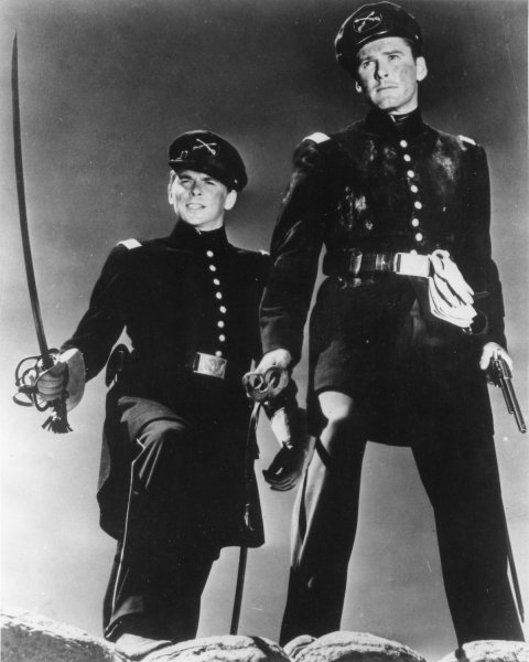 Ronald Reagan (L) is George Armstrong Custer and Errol Flynn is Jeb Stuart in this promotional still from the 1940 movie Santa Fe Trail. Reagan, the 40th President of the United States of America, was instrumental in bringing about the collapse of communism and an end to the Cold War. The former President is now 92 and has been suffering from alzheimer's for over ten years. (UPI/File)