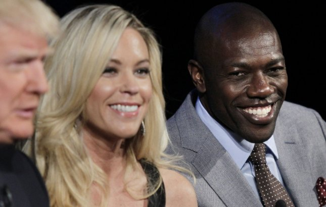 Kate Gosselin and Terrell Owens sit on the stage at the Celebrity Apprentice Season 14 red carpet and press conference at Chelsea Piers in New York City on March 20, 2014. UPI/John Angelillo