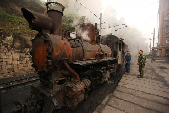 An old Jiayang Railway steam train arrives to hitch up to passenger carriages at the Shixi depot in Jiayang, a small mountainous city in Sichuan Province, China, on Saturday. Photo by Stephen Shaver/UPI