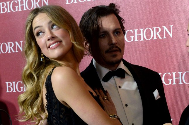 Actors Amber Heard and Johnny Depp attend the 27th annual Palm Springs International Film Festival awards gala on January 2, 2016. File Photo by Jim Ruymen/UPI