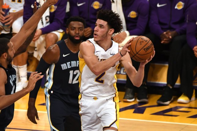 Los Angeles Lakers guard Lonzo Ball (2) drives against Memphis Grizzlies guard Tyreke Evans (12) in second-quarter action on November 5, 2017 at Staples Center in Los Angeles. Photo by Jon SooHoo/UPI