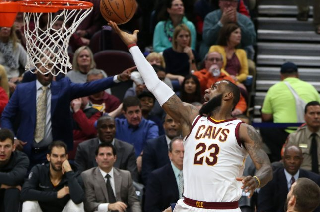 Cleveland Cavaliers' LeBron James lays the ball in for a basket past Memphis Grizzlie defender Marc Gasol during the first half on December 2 at Quicken Loans Arena in Cleveland, Ohio. Photo by Aaron Josefczyk/UPI