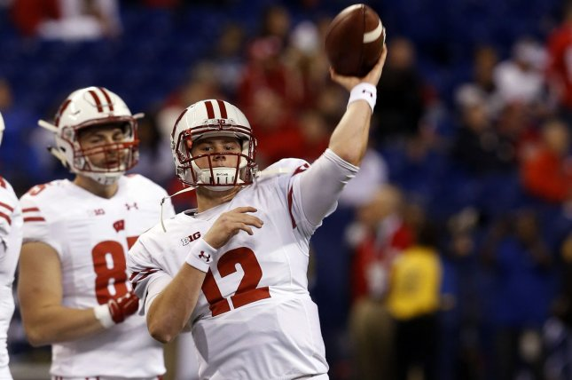 Wisconsin Badgers quarterback Alex Hornibrook (12) throws during warm-ups before their game against the Penn State Nittany Lions in the 2016 Big Ten Football Championship Game on December 3, 2016 in Indianapolis. File photo by John Sommers II/UPI
