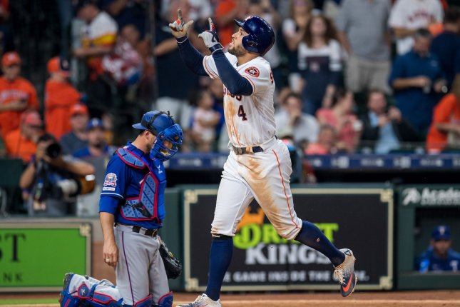 Houston Astros outfielder George Springer celebrates after hitting a solo home run against the Texas Rangers earlier this week. Springer had five hits against Texas Sunday. Photo by Trask Smith/UPI