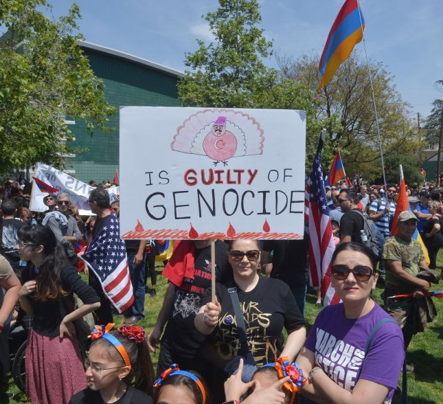 Thousands of people march from Los Angeles' Pan Pacific Park to mark the 102nd anniversary of the Armenian genocide on April 24, 2017. The House recognized the genocide with an overwhelming vote Tuesday. File Photo by Jim Ruymen/UPI