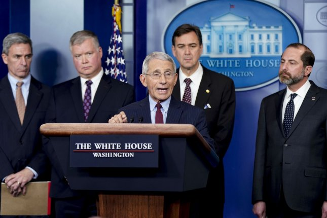 National Institutes of Health official Dr. Anthony Fauci (C) speaks about the coronavirus during a press briefing at the White House on Friday. Attendees included members of President Donald Trump's Coronavirus Task Force. Photo by Leigh Vogel/UPI
