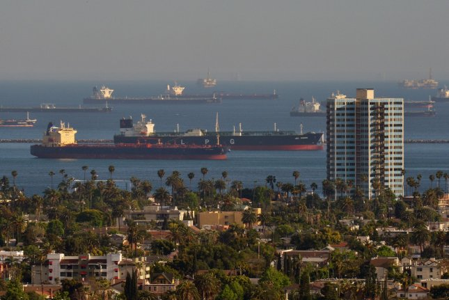 Oil tankers are anchored near the Los Angles and Long Beach port complex in Los Angeles on Thursday. Beach remain closed in Los Angeles County, including Long Beach. Photo by Jim Ruymen/UPI