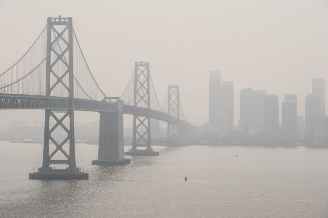 Smoke from fires in Northern California lowers visibility of the Bay Bridge and San Francisco as viewed from Yerba Buena Island on October 2. Scientists have linked climate change to an increased risk for wildfires. File Photo by Terry Schmitt/UPI