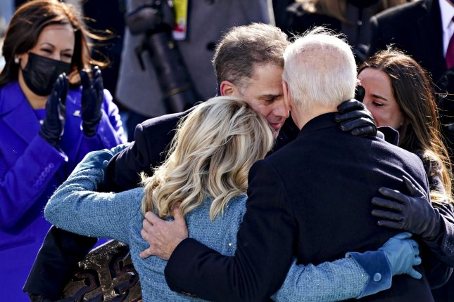 UPI photographer Kevin Dietsch won the first-place prize in the White House News Photographers Association 2021 Eyes of History contest for this photo of President Joe Biden embracing his family as after being sworn in. Photo by Kevin Dietsch/UPI