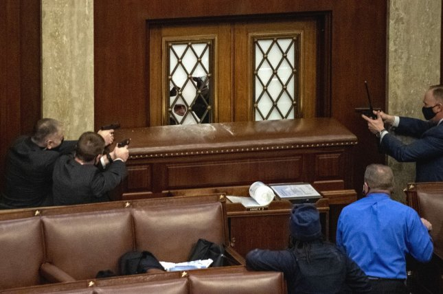 Security officers train their weapons on rioters inside the U.S. Capitol on January6. File Photo by Pat Benic/UPI