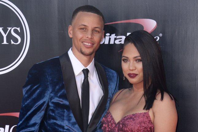 Stephen Curry (L) surprised his wife, Ayesha Curry, with a vow renewal ceremony officiated by their daughter Riley Curry. FilePhoto by Jim Ruymen/UPI