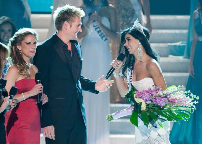 Rima Fakih, 24, of Dearborn, MI, speaks to Joan Rivers and Melissa Rivers (not pictured) after being crowned Miss USA 2010, while hosts Natalie Morales and Curtis Stone look on in Las Vegas, Nevada on May 16, 2010. The Lebanese-American woman is the first of Arab descent to be crowned Miss USA. (EDITORIAL USE ONLY-NO USE AFTER 60 DAYS) UPI/Darren Decker/HO-Miss Universe L.P., LLLP.