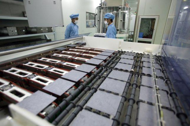 Chinese employees work at the Yingli Group's photovoltaic manufacturing plant, building solar power modules, in Baoding City, Hebei Province on June 24, 2009. China, the world's number two energy user and the largest emitter of greenhouse gases, is mapping out a plan to stimulate its renewable energy sector, including wind and solar power. China is the world's largest solar-panel producer. (UPI Photo/Stephen Shaver)