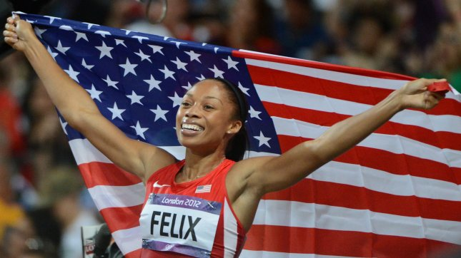 Allyson Felix celebrates winning the gold medal in Women's 200M at the London 2012 Summer Olympics on August 8, 2012 in London. UPI/Terry Schmitt