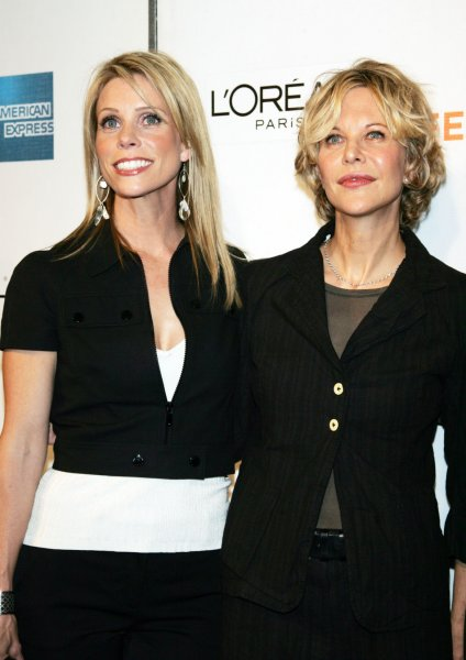 Cheryl Hines (L) and Meg Ryan arrive for the Tribeca FIlm Festival premiere of Serious Moonlight at the Tribeca Performing Arts Center/BMCC in New York on April 25, 2009. (UPI Photo/Laura Cavanaugh)