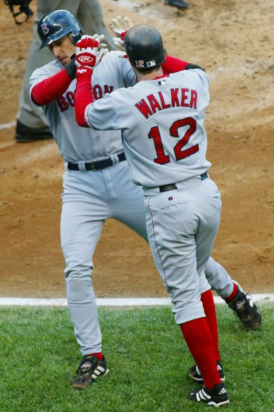 Boston Red Sox's Nomar Garciaparra, left, and Todd Walker congratulate one another after being driven home on David Oriz's two-RBI single in the third inning to put the Red Sox ahead 3 to 1 during game six of the American League championship series playoff against the New York Yankees at Yankee Stadium in New York City on October 15, 2003. The Red Sox end up winning 9 to 6. (UPI/MONIKA GRAFF)