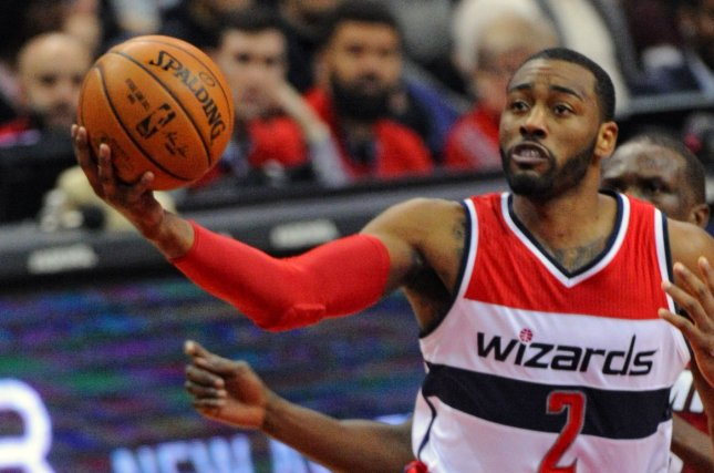 Washington Wizards guard John Wall (2) scores against Miami Heat forward Luol Deng (9) in the first half at the Verizon Center in Washington, D.C. on January 20, 2016. Photo by Mark Goldman/UPI