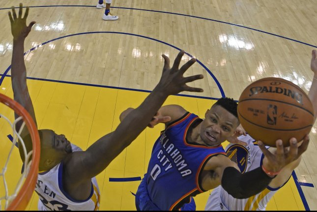 Oklahoma City Thunder's Russell Westbrook (0) goes up for a layup past Golden State Warriors' Draymond Green (23) in the fourth quarter of Game 1 of the NBA Western Conference finals at Oracle Arena in Oakland, California on May 16, 2016. Pool photo by Jose Carlos Fajardo/UPI