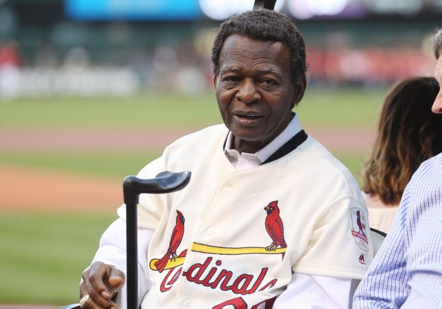 Former St. Louis Cardinals and member of the National Baseball Hall of Fame, Lou Brock, rides in a golf cart following ceremonies commemorating the 50th anniversary of the 1967 World Series between the Boston Red Sox and the St. Louis Cardinals in May. Photo by Bill Greenblatt/UPI