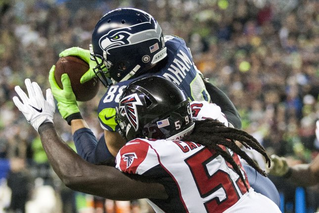 Seattle Seahawks tight end Jimmy Graham (88) catches a four-yard touchdown pass against Atlanta Falcons outside linebacker De'Vondre Campbell (59) during the first quarter Monday at CenturyLink Field in Seattle, Wash. Photo by Jim Bryant/UPI