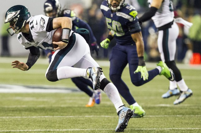 Philadelphia Eagles quarterback Carson Wentz (11) scrambles for a 11-yard gain against the Seattle Seahawks during the first quarter at CenturyLink Field in Seattle, Washington on December 3, 2017. File photo by Jim Bryant/UPI