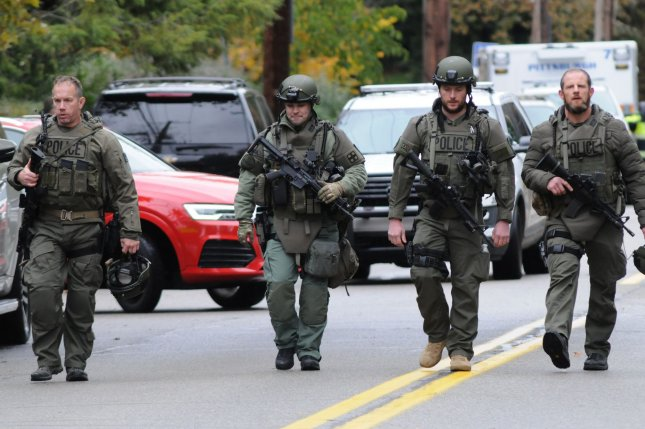 Pittsburgh police officers depart the scene of the mass shooting at the Tree of Life Synagogue in the Squirrel Hill neighborhood of Pittsburgh where at least 11 people died Saturday. Photo by Archie Carpenter/UPI