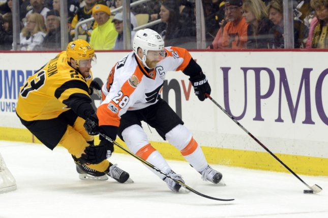 Philadelphia Flyers center Claude Giroux (28) and defenseman Justin Braun were identified as the two players who were put in the NHL's COVID-19 protocols on Tuesday. File Photo by Archie Carpenter/UPI