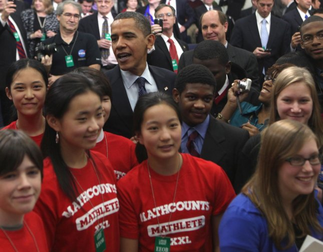 U.S. President Barack Obama poses for a photograph with students from Longfellow High School and Oakton High School at an event highlighting several initiatives designed to boost science, technology, engineering, and mathematics education in the Eisenhower Executive Office Building adjacent to the White House in Washington on November 23, 2009. UPI/Dennis Brack/POOL