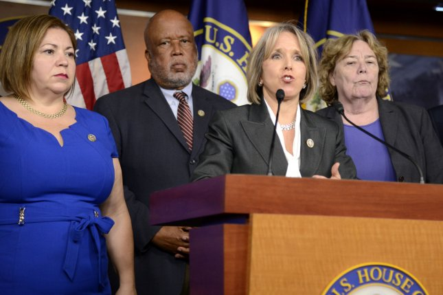 Rep. Michelle Lujan Grisham, D-N.M., chairwoman of the Congressional Hispanic Caucus, speaks as (L-R) Reps. Linda Sanchez, Benny Thompson and Zoe Lofgren listen during a press briefing on Capitol Hill on Thursday. Photo by Mike Theiler/UPI