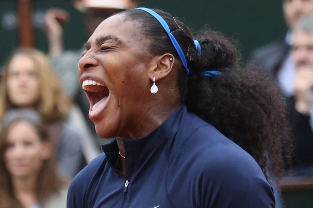 American Serena Williams reacts after a shot during her 2016 French Open women's final match against Garbine Muguruza of Spain at Roland Garros in Paris, France. File photo by David Silpa/UPI
